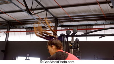 Determined beautiful Caucasian woman doing jump squat in ...
