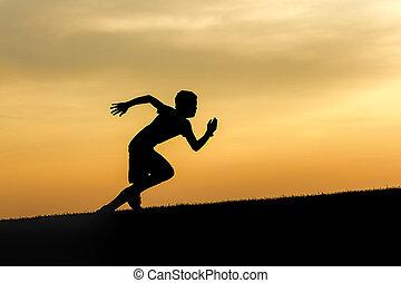 Determined boy runs uphill.