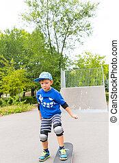 Determined Boy Skateboarding in Skate Park