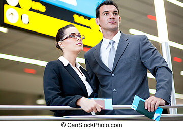 determined business travelers in airport