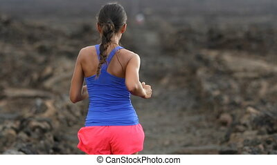Determined Female Athlete Running On Arid Landscape - ...