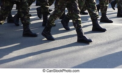 Determined Military Boots March - Close up with soldiers...