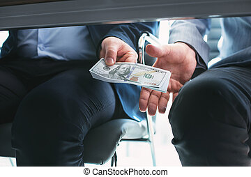 Determined rich businessman giving a bribe
