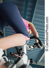Determined young woman working out at spinning class - Low...