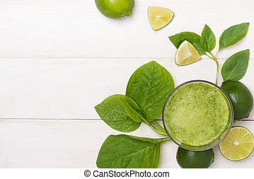 Detox concept. Glass jar of fresh drink green smoothie, spinach leaves, cucumber, apple, lime fruit.