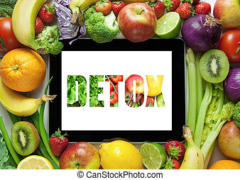 Computer tablet screen with detox text block letters in the shape of fruits and vegetables