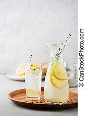 Detox drink of lemon, ginger and thyme.