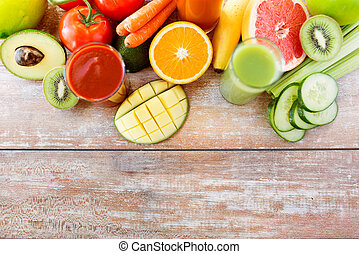 close up of fresh juice glass and fruits on table - detox,...