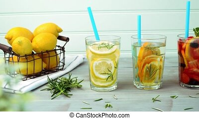 Detox water cocktails on wooden table.