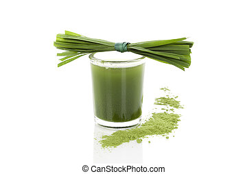 Wheatgrass powder, grass blades and green juice isolated on white background. Alternative medicine, detox.