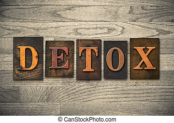 """The word """"DETOX"""" written in vintage wooden letterpress type."""
