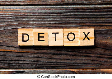 detox word written on wood block. detox text on wooden table for your desing, concept
