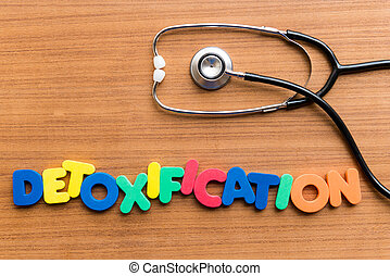 DETOXIFICATION colorful word on the wooden background
