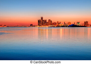 Detroit, Michigan Skyline at Sunset overlooking the Detroit River from Belle Isle Park with a view of the Ambassador Bridge.