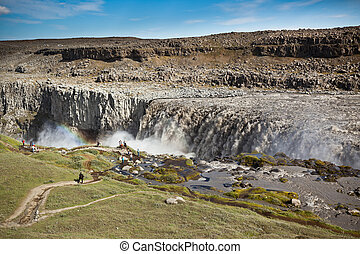 Dettifoss Waterfall in Iceland under a blue summer sky with clou