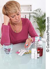 deux âges, femme, prendre, elle, médicament