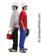 deux, électriciens, tenu, nouveau dos