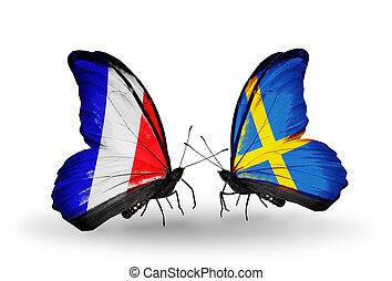 deux, papillons, à, drapeaux, sur, ailes, comme, symbole, de, relations, france, et, suède
