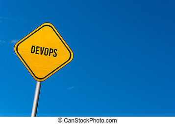 Dev Ops - yellow sign with blue sky