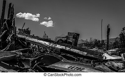 Devastation - House burned to the ground. House numbers over...