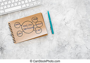 Develop a business strategy. Office table with sketch in notebook on grey background top view copyspace