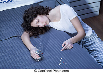 Developing addiction to sedatives - Young woman with a glass...