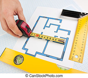 development drawings and tools on graph paper