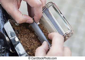 Device for roll-up of a cigarette with a tobacco.