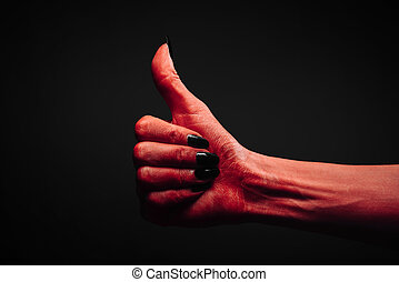 Devil hand with thumb up gesture