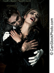 devil kiss - Bloodthirsty male vampire in medieval dress is...