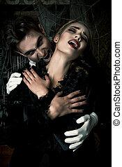 devil kiss - Bloodthirsty male vampire in medieval dress is...