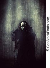 devil robe - Scary man in iron mask and black robe. Fantasy....