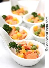 corn salad snacks in small sampling spoons. - Deviled corn...