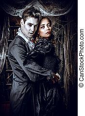 devilish love - Beautiful man and woman vampires dressed in...