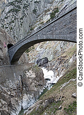 Devil's bridge at St. Gotthard pass, Switzerland. Alps. ...