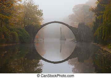 Devil's bridge in early morning mist