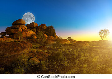 Devils Marbles with moon