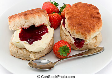 Traditional Afternoon Tea of Devonshire scones topped with clotted cream and strawberry jam often served with coffee or tea