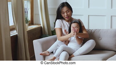 Devoted affectionate young vietnamese ethnicity mother ...