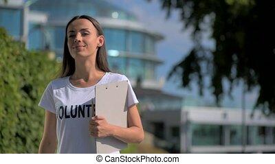 Devoted female volunteer walking in the park - Important...