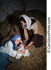 Devoted parents in Christmas nativity scene