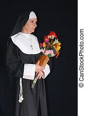 Devout nun - Middle aged devout nun in deep thoughts,...