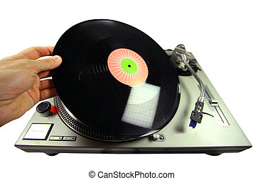 dex spin - a hand putting a record on a turntable