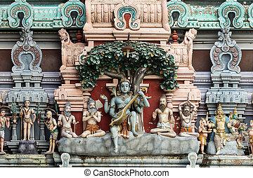 Dhakshinamoorthy statue on the Gopuram. - Dhakshinamoorthy...