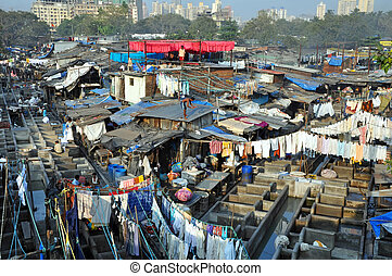 DELHI, INDIA - 5 NOVEMBER, 2009: An unidentified Indian people work at Dhobi Ghat in Mumbai on November 5, 2009. Dhobi Ghat is the the world's largest outdoor laundry and work there nearly 200 dhobi families.