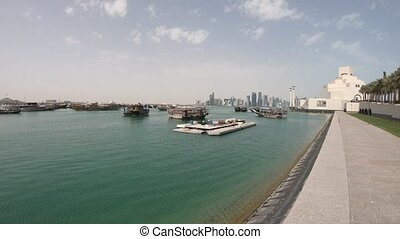 Dhow Harbour Doha - Doha seafront with palm trees and West...