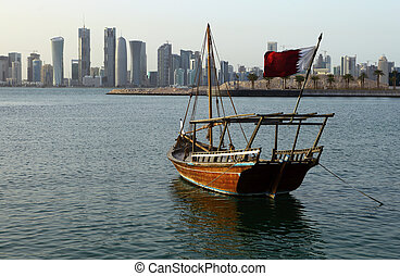 Dhow with flag and skyline