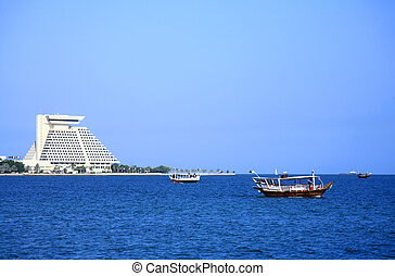 Dhows in Doha Bay, Qatar - Three dhows ferrying sightseers...