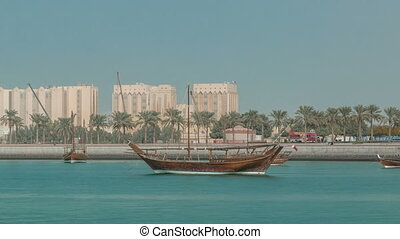 Dhows moored off Museum Park timelapse in central Doha,...