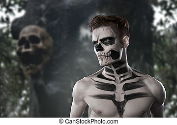 Dia de los Muerto Costume - Day of the dead is a mexican holiday. Here is a man with skull face and blurry background
